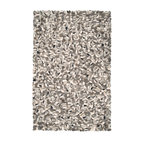 Surya - Surya Summit SMT-6600 (Gray, Charcoal, Ivory, Black) 8' x 10' Rug - Surya's newest Best Selling Rug Line is also one of its most avant-garde creations to date. The rugs of the ultra contemporary Summit Collection are hand-knotted from felted wool to create a surface texture like nothing ever seen. Large bundles of wool have been artfully arranged in an intricate puzzle pattern resulting in an overall effect that is pure cutting edge design. Available in dramatic color palettes of steel gray, white and black, these striking rugs are sure to take center stage in any modern interior.