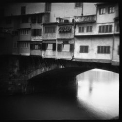 """""""Ponte Vecchio"""" Artwork - Don't you just love these mysterious black and whites where you can make up your own story? Maybe this snapshot is Venice, taken by a jilted lover from a canoe on a solitary pilgrimage toward healing. Or perhaps it reminds you of Madonna's """"Like a Virgin"""" video you're expecting her to pop up and start crooning. Or ... what tale is it telling you?"""