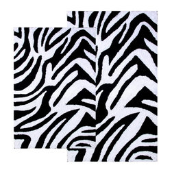 Chesapeake Merchandising - Chesapeake 2 pc. Zebra Bath Rug Set - 26708 - Shop for Mats and Rugs from Hayneedle.com! Take a walk on the wild side right out of the shower. The contemporary Chesapeake 2 pc. Zebra Bath Rug Set has a non-slip backing to ensure a safe step and its black/white or chocolate/ivory color options will no doubt complement your decor. Set includes two matching rugs. Set Dimensions: Large rug: 24 x 40 inches Small rug: 21 x 34 inches About Chesapeake Merchandising Inc. Started in Maryland in 1995 Chesapeake Merchandising Inc. remains dedicated to producing quality textiles from the finest raw materials. Purveyors of fine rugs linens pillows and bedding they strive to stay abreast on the latest trends in the industry in order to provide their customers with the most up-to-date styles for their homes. Chesapeake employs dedicated workers with a passion for quality. Their facilities are located in both India and the United States; their permanent showroom is located in New York New York.