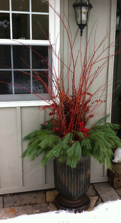 Our Winter Containters - A soft layer of pine compliments arching branches of orange-red flame willow, died eucalyptus and winter berry in this beautiful winter planter designed by The Branch Ranch. Photography @2013Jackie Stafford