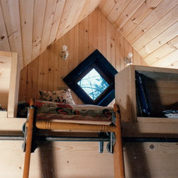 Signature Writer's Cabin - This sleeping loft comes with dual purpose bookshelves.  They serve as extra storage for books and accessories.  It also serves as a safety shelf to keep you from falling out of bed at night.