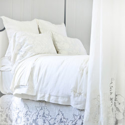 """Pom Pom at Home - Pom Pom at Home Caprice Duvet Cover - Pom Pom at Home's bedding and accessories lend lived-in elegance to everyday experiences. The white Caprice duvet cover dresses the traditional bedroom with timeless sophistication. Delivering a refined accent, this bedding features delicate floral cutwork detailing and soft texture for romantic femininity. Available in two sizes. Made from 100% linen. Queen: 88""""W x 88""""H. King: 104""""W x 90""""H."""