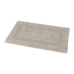 Prestige Cotton Bath Rug Carla Beige - This prestige cotton bath rug Carla is 100% cotton. Ultra-soft, deep, and inviting, this bath mat is a rug you can luxuriously sink your toes in and will give a sophisticated look to any bathroom. This beautiful bath rug features a simple design with an outlined interior border. It provides a soft, cushioned feel, shock absorption and is durable. Manufacturer recommends using a nonskid pad beneath the rug (not included). Hand wash and no dryer. Indoor use only. Width 20-Inch and length 31.5-Inch. Color beige. Enhance your bathroom decor with this handsome prestige bath rug and add an understated elegance to your space. Imported.