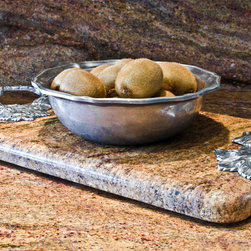 Custom Granite Serving Tray or Hot Plate - This custom serving tray is a wonderful way to use the granite from a cooktop or sink cutout. It makes for a lovely hotplate on a wood or glass table or sideboard. We can attach any handle (drawer handles make granite handles for these trays). We don't charge extra to make this from our clients extra stone. Many clients ask for a cutting board, but we usually decline simply because the granite will dull your knives. The granite won't scratch, but you will ruin your cutlery.