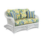 WickerParadise - Lanai White Wicker Loveseat - Sink into this super comfortable loveseat and while away the afternoon with a glass of lemonade or a margarita and your favorite Jimmy Buffet CD. Its strength and durability combined with comfort and beauty will grace your home for years and years.