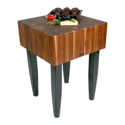 John Boos - Kitchen Square Block Table - Includes board cream with beeswax. Black legs tapered at the bottom. End grain construction. Warranty: One year against manufacturing defects. Made from solid walnut. Walnut finish. Stand height: 34 in. H. Block: 24 in. L x 24 in. W x 10 in. H (166 lbs.). Quick ship