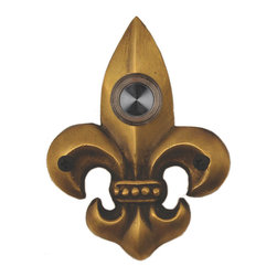 Waterwood - Brass Small Fleur De Lis Doorbell in Antique Brass - The Waterwood Small Fleur de Lis doorbell is a symbol of French royalty, and is found in designs across Louisiana, especially in New Orleans. Displaying this doorbell will help you project a spirit of elegance from the front door of your home. This solid brass doorbell is crafted using the sand casting technique. It is then hand finished and coated with a protective lacquer to withstand the elements. Waterwood doorbells are easy to install and will add personality to your home. It comes with a lighted push button and mounting screws.