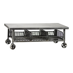 Coffee Table, Grey - With a true industrial style, this coffee table is an eye-catching addition to the modern living room. The rectangular metal table has stark lines offset by large spoke-style metal wheels and is finished in a distressed silvery gray. The lower shelf of the table holds three baskets with pull handles for additional storage, perfect for books or magazines. Show off your distinctive contemporary style with this interesting coffee table.