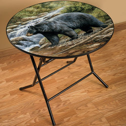 "Bear Scene Folding Table - Perfect for extra dinner guests or game nights  the Bear Scene Folding Table has a tubular steel base and durable laminate top with appealing black bear artwork. Measures 36""Dia. x 30 1/2""H; 9""D when folded. ~"