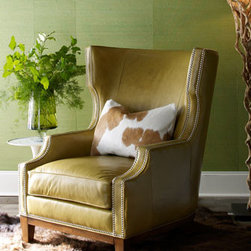 """Massoud - Massoud Green Leather Chair - Exclusively ours. Oversized wingback chair with hardwood frame, spruce-green leather upholstery, and nailhead trim is handcrafted in the USA. Longhorn-chocolate hairhide pillow with goose down fill included; pattern on hairhide will vary. 36""""W x 42""""D...."""