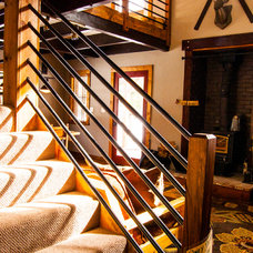 Rustic Staircase by J. Tight Interiors
