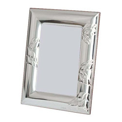 "Silverstar International - 3.5""x5"" Maria Sterling Silver Frame - Maria anniversary photo frame is a contemporary sterling picture frame that features a pleasingly asymmetrical embossed grape flower motif. The Silverstar International bi-laminated 925 Sterling Silver picture frame is meticulously manufactured to an aluminum base for strength & attached to a veneer mahogany wooden back and easel. It also has a rich mahogany back and easy-to-use slide tab closures, ensuring easy access to your photograph."