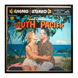 """Glittered South Pacific Soundtrack Album - Glittered record album. Album is framed in a black 12x12"""" square frame with front and back cover and clips holding the record in place on the back. Album covers are original vintage covers."""
