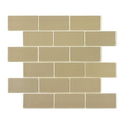 Spa Glass - Soho 2x8 Subway Glass Tile BOX - Our hottest style of warm taupe, Soho2X8 Glass Subway Tile,  is a vibrant and lustrous glass tile rich in dimension with it own unique color and foil backing for a distinctive resonance.  8 mm thick and priced per 8X16 sheet or piece, each tile is .914 sq  Perfect for brightening any space, this is the ideal tile for a backsplash, kitchen tile or bathroom tile. The tiles are mesh mounted which allows for easy installation. The tiles are not pool rated but are typically used for wet areas (not warrantied for this usage), back splashes and feature walls. Each piece is an 8X16 tile (.914 square feet)and softly beveled. They come in boxes of 9.14 square feet or 10 sheets.The Price is per SHEET. The only purchase option is per BOX purchase which is 9.14 square feet or ten sheets. There is also a SAMPLE option ( one 2X8 tile only) so you can confirm the color is perfect for your space.