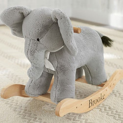 Elephant Plush Rocker - Take the normal notion of a rocking horse, and throw them out the window! This elephant will provide hours of fun for both boys and girls, while looking precious at the same time.