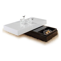 MODERN RECTANGULAR SWIVEL WHITE COFFEE TABLE WITH STORAGE KANI - Modern swivel rectangular top coffee table with storage Kani can also be described as a dual table. It is rectangular in shape with features of a modern coffee table. The style as well as functionality is absolutely amazing. This table has a handy storage section that is hidden beneath the shiny white coffee table top which also swivels.
