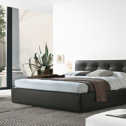 Maxim Bed - Maxim Bed is a wooden frame bed, paddedin polyurethane in different density. Completely upholstered in removable fabric or non-removable leather-look or leather. The headboard is enriched with a removable capitonne finishing. Available with or without storage.