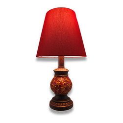 Brown and Brick Red Accent Lamp 15 In. - This lamp is a wonderful addition to entryway tables, desks, and accent tables in your home. The bulbous base is made of cast resin and features a brick red background with raised golden scrollwork, topped off with a red fabric covered shade. The lamp measures 15 inches tall, has a 4 inch diameter base, and the shade is 7 inches tall by 8 inches in diameter. It uses a 25 watt (max) type A bulb (not included), and has a black 5 foot long power cord.