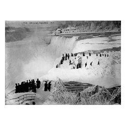 Ice Bridge, Niagara Falls, 1912 Print - Ice Bridge, Niagara 1912, photographed by the Bain News Service from the Canadian side of the falls toward the USA in 1912 on 5x7 glass plate negative. Summary: Photo shows Luna Island with ice bridge and the Honeymoon Bridge (Upper Steel Arch Bridge) in the background, Niagara Falls.