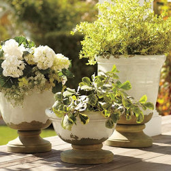 """Tuscan Planters - I love the rustic look, don't you? These distressed white planters just scream, """"Oh, I've had these forever, and I'm simply too preoccupied with much more pressing matters (like making gin and tonics and looking at the stars) to repaint them."""" Line your outdoor space with similarly casual aplomb."""
