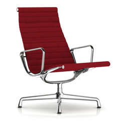 Charles & Ray Eames - Herman Miller Eames Aluminum Lounge Chair, Fabric - Herman Miller Eames Aluminum Lounge Chair  Fabric Upholstery  designed by Charles and Ray Eames    At A Glance:   The Eames Aluminum Group Chairs were originally designed to function both indoors and outdoors, but they soon transitioned to solely indoor pieces. At first glance, it is easy to see why - these pieces are as much art as they are pieces of furniture, and when something looks this good you don't keep it outside. Added to make the chair even more comfortable is the ottoman, which comes in handy when you use the chair like a recliner (as you should). Because the seat of the chair is the same size as the other chairs in the series, you need a place to rest your legs when you're reclining. The ottoman looks just as beautiful as the chair, with the same materials, and it features the same suspension techniques used in the lounge chair.      The Lounge Chair features an exposed, l