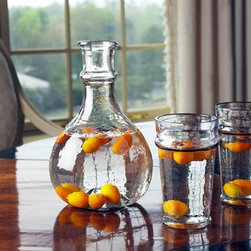 Castilian Decanter - Your guests will enjoy the look as well as the feel of this elegantly simple hammered glass decanter. Features a gently rounded base and thick walls for greater weight and stability.