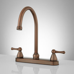 Stratton Gooseneck Kitchen Faucet - Featuring a tall gooseneck spout that swivels, this charming kitchen faucet makes food preparation or dish washing easy. Looks great with any kitchen sink.