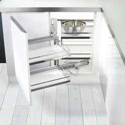 Magic Corner Cabinet - The Magic Corner is a great solution for your blind corner cabinet.  No longer will you have to reach into the back corner of your blind corner.  Just open the door and all the contents of your cabinets glide out on smooth German engineered bearings.