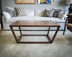The Uptown Coffee Table - Brandner Design - The Uptown Coffee Table is a sophisticated deign with soft lines and a confident stance.  Handmade from Black Walnut with the highest attention to detail and quality.  Sealed with a durable lacquer clearcoat, this table will withstand years of use and still look timeless.  Available as a dining table in custom sizes.  Contact us at sales@brandnerdesign.com.