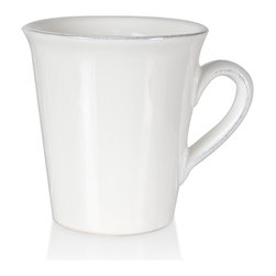 Clos du Manoir Mug - A graceful arched handle, a neat emphasized rim, and a tall, lean profile let the Clos du Manoir Mug convey caf� elegance.� Easy to match to your decor because its white porcelain construction is both so versatile and so appealing, this mug has an unusual geometry that makes elegant French press coffee feel all the more modish.� These transitional mugs complement any dish.
