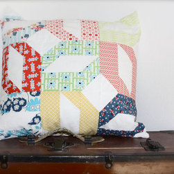Modern Quilt Patchwork Pillow Cover By Knit Shear Bliss - This quilted cover would be perfect in a farmhouse family room or guest bedroom. The unique pattern and geometric shapes keep it from feeling frumpy.