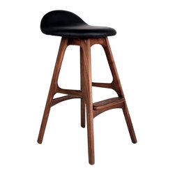 Erik Buck Counter Stool, Walnut/Black - Straddle the saddle of this Erik Buck 1960s design. This comfortable stool features a gently curved seat upholstered in top grain leather for that extra comfort. You're perched atop a stool with solid American ash or walnut legs that are spanned at different heights by footrests.