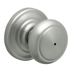 "Schlage - Andover Satin Nickel Bed and Bath Knob - FA40 - Manufacturer SKU: FA40 AND 619. Handle Type: Knob. Push button locking for use on bedroom and bathroom doors. All Metal Chassis for Strength and Durability. Universal knob works for right or left handed doors. Limited Lifetime Mechanical and Finish Warranty. Coordinate with other Andover Satin Nickel products. Designed for standard door prep (fits existing pre-drilled holes). Universal latch adjusts to fit 2-3/8"" or 2-3/4"". Fits 1-3/8"" to 1-3/4"" wood or metal doors. Shown in Satin Nickel. 2.4 in. L x 2.8 in. W x 2.8 in. H (1.1 lbs)"