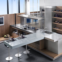 Porcelanosa Kitchen Cabinets - The G680 Nogal Sienna Kitchen features stainless steel and natural wood. All of Porcelanosa's kitchens are custom made according to your specifications and many door styles offering beautifully integrated door and darer pulls.