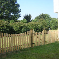 """Spaced Picket - This spaced picket fence is 4' tall and comes in both 2"""" and 1 and 1/2"""" spacing. Featuring a scalloped top, the boards are 1""""X4""""."""