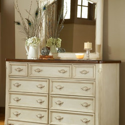 None - Crescent Manor 9-drawer Dresser and Optional Mirror - This elegant dresser in vintage antique white finish with its graceful curves boasts nine spacious drawers with felt lining in the top three to keep your treasured items safe.