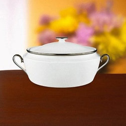 Lenox Solitaire White Covered Vegetable Bowl - Give your veggies the treatment they deserve with the Lenox Solitaire White Covered Vegetable Bowl. In other words, make them look better for veggie lovers, and make them look appetizing to the vegetable-averse. This elegant veggie bowl is perfect for serving your favorite greens, and the lid keeps them warm during long dinners. The pristine white coloring is accented by platinum banding, which creates a minimal look that blends with any home. Crafted of fine china, this bowl is dishwasher-safe for convenience.About LenoxThe Lenox Corporation is an industry leader in premium tabletops, giftware, and collectibles. The company markets its products under the Lenox, Dansk, and Gorham brands, propelled by a shared commitment to quality and design that makes the brands among the best known and respected in the industry. Collectively, the three brands share 340 years of tabletop and giftware expertise.