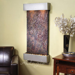 Slate Wall Mounted Water Features -The Whispering Creek with Rajah Slate - The Whispering Creek Wall Water Wall Fountain at $899 is captivating, beautiful and a fantastic price for its size and quality. This beautiful slate fountain is simply a perfect piece of art for any room, bringing peace and harmony to any space. The Whispering Creek is a rustic, warm, natural indoor wall fountain that will put a smile on even the toughest critic's face. Hand crafted by the finest artisans this Whispering Creek wall mounted fountains piece includes step- by- ste instructions to make it an ease to install. The Whispering Creek is available several powder-coat finishes.