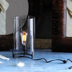 Clear Glass Edison Light Lamp - This clear table lamp is made for showcasing a cool vintage looking light bulb. Thankfully, one is provided here to really show the fixture's style potential.