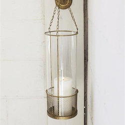 Innkeeper Hanging Wall Lantern - The soothing glow of candlelight will look oh so chic radiating from the brassy confines of this wall-mounted glass lantern. Tall, clear glass sides protect hands from the flame, while providing delicate beauty against the antiqued golden metal.