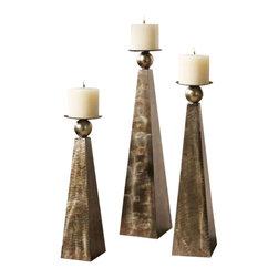 Uttermost Cesano Bronze Candleholders, Set/3 - Brushed, heavily antiqued, rustic bronze finish. Distressed beige candles included. Brushed, heavily antiqued, rustic bronze metal finish. Distressed beige candles included. Sizes: sm-5x18x5, med-5x22x5, lg-6x26x6