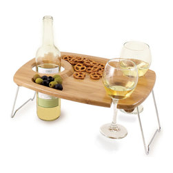 Picnic Time - Mesavino Folding Picnic Table - The Mesavino is a beautifully hand-crafted solid bamboo table with carved-out sections to hold one wine or champagne bottle and two wine glasses. Nested between the wine bottle and glasses is a spacious carved-out tray to hold your appetizers. It's perfect for romantic picnics or the beach..anytime you need a sturdy table to hold your wine and food. Chrome-plated legs fold flat against the table for easy storage and transport. The Mesavino is convenience made easy!