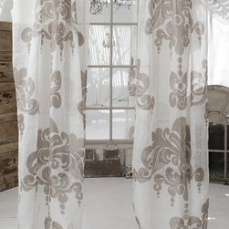"Couture Dreams Enchantique Ivory/Sand Linen Panels - Couture Dreams Enchantique Linen Gauze Window Panels are what we like to call a French inspired Art Deco with a Modern Twist. Truly beautiful and unique these rustic chic linen gauze window panels are each hand printed with a large decorative motif. Offered in three different colorways and lengths, these panels are sure to dress up any room. These window panels can be combined with any type of home decor from modern to traditional. Panels hang on a 4"" rod pocket, which can either slide directly onto the pole or can hang from rings with clips. They are made from fine, premium quality 100% linen gauze fabric which is delicate and refined."