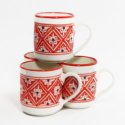 """Le Souk Ceramique - Coffee Mugs - Set of 4 - Dishwasher & Microwave Safe. Not for Use in Oven or Freezer. Hand Painted (truly 100% free hand) using only food safe paints & glazes. Each piece is truly artisnal by nature & as such, small variances in size, color, & artwork should be expected & appreciatedNejma means """"star"""" in Arabic. Wanting to create a geometric design with the predominant color being a bright red, what resulted is the most intricate and difficult design we have ever made but certainly worth the effort. Imagine a heavenly table set sumptuously with Nejma and appreciate the freehand painting by our stars, the artists of Le Souk Ceramique.The Le Souk Ceramique studio is located in Nabeul, Tunisia on the Mediterranean coast with US headquarters & distribution in Clinton, Washington State"""