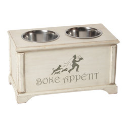 "Large ""French Country"" Elevated Dog Feeder - Our French country design is inspired by the beauty and charm of rural France. Your dog is sure to appreciate the delightful ""Bone Appétit"" artwork which plays on the well-known French culinary skills. This unique raised dog diner has a relaxed feeling with a touch of European Elegance. The distressed cream color finish portrays a welcome, lived-in look, while complementing most kitchen designs."