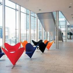 Panton Heart Cone Chair - Vernor Panton's Heart Cone Chair is a whimsical iconic swivel chair that designers have been using in ways both sleek and cheeky since 1958.