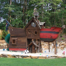 Scallywag Pirate Tree House - Isn't it every little boy's (or girl's for that matter) dream to be a pirate at some point in their life? This play house lets them live out their fantasy with awesome details and even a slide!