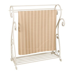 Passport - Quilt Rack in Whitewash Finish - Holds multiple quilts. Scrolling and bottom shelf for extra storage. Sturdy enough for the heaviest of quilts. Six months warranty. Minimal assembly required. 31 in. W x 14.75 in. D x 36 in. H (10 lbs.)