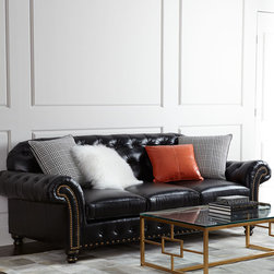 """Massoud - Blackburn Sofa - BLACK - MassoudBlackburn SofaDetailsEXCLUSIVELY OURS.Classic black tufted-leather sofa.Hardwood frame.Leather upholstery.Includes two plaid pillows one Santa Fe orange pillow and one Tibetan lambswool pillow.Suspended coil-spring system; mortise-and-tenon frame construction.99""""W x 42""""D x 36""""T. Seat 19""""T; arms 28""""T.Made in the USA.Boxed weight approximately 230 lbs. Please note that this item may require additional delivery and processing charges.Designer About Massoud:Company president Chuck Massoud's father combined his entrepreneurial spirit with loans from three friends to start Massoud Furniture in 1962. Since then the Massoud family has been crafting its distinctive brand of custom seating. Massoud is credited for putting pitch in their wing chairs leaning them back slightly makes them so much more comfortable than the classic wing chair with a straight back. All Massoud furniture features kiln-dried hardwood frames and the finest leathers and fabrics available. They also employ multiple support rails reinforced corner blocks mortise-and-tenon joinery and suspended coil systems for comfort and quality craftsmanship that lasts a lifetime."""