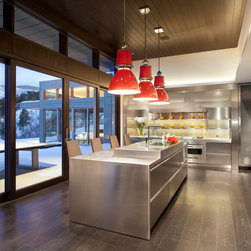 Aluminum Clad Windows and Doors - Lift and slide doors are featured throughout this luxury Aspen retreat.  Photo credit Brent Moss Photography.